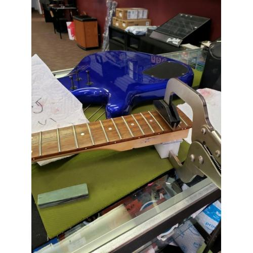 """Customer image:<br/>""""Every single fret on this bass was loose.  The Fret Press was easy to use, and made quick work of the project!"""""""