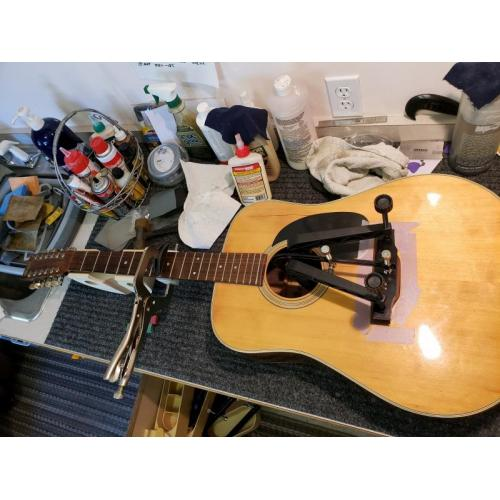 """Customer image:<br/>""""Almost every fret on this 12 string was loose.  I worked the frets while the bridge reglue dried.  The Fret Press made this customer&amp;#039;s guitar economical to repair.  """""""